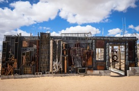 A large Purifoy work in the desert, weathering well.